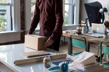 Man preparing to open online delivery package